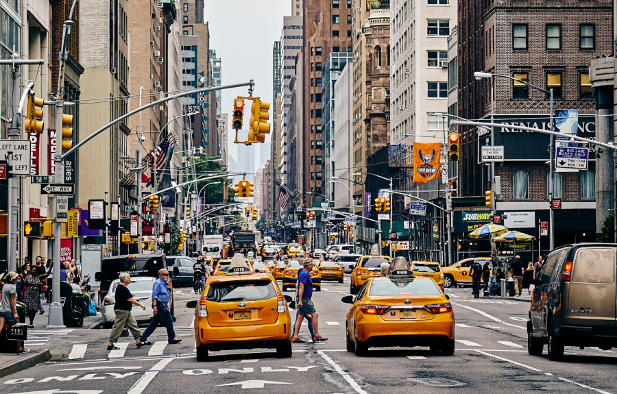 Busy street in New York with yellow cabs.